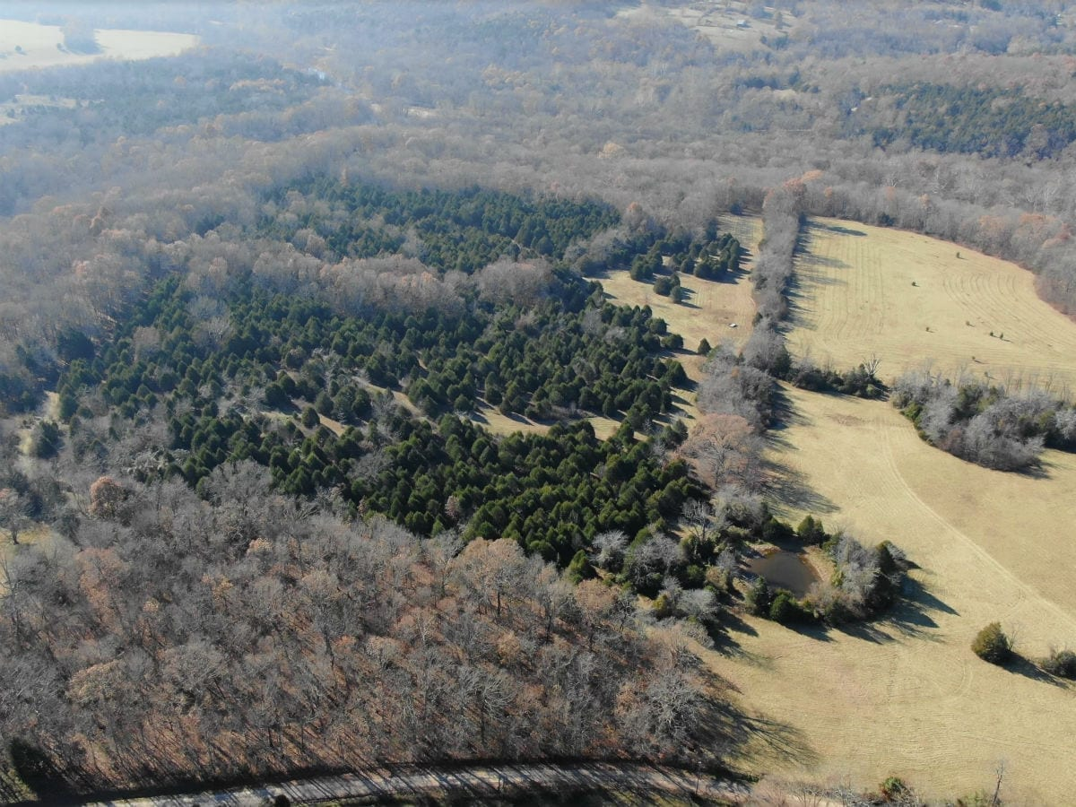 Aerial photo over the county road looking towards the property.