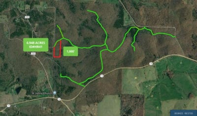 The green lines are the easement roads which you can use to access the property.