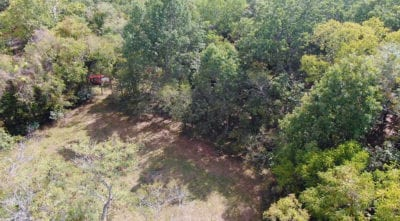 Aerial looking down at a small meadow on the south end of the property