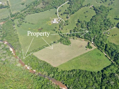 Aerial looking southeasterly at the property