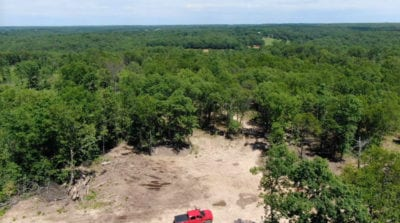 Aerial looking east over the property with the truck parked on the easement road.