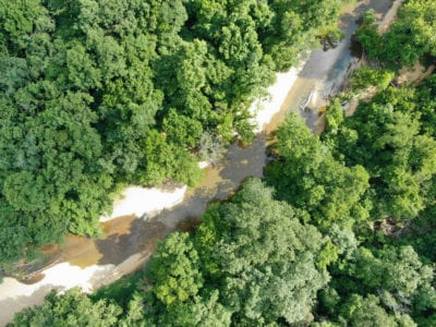 Aerial looking down at part of the river frontage.