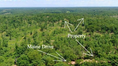 Aerial looking easterly over Maine Drive at the property.
