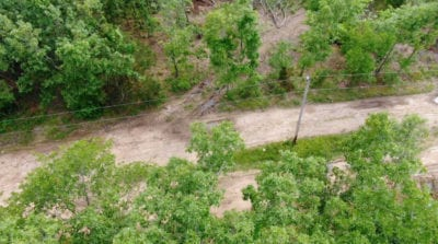 Looking down on the power line which runs across the property.