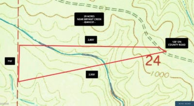 Topo map showing how the property is situated. From the County Road, it slopes down as you move west toward the creek bed. It then slopes back up as you continue going west and there is a large level area at the west side of the property.
