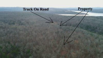 Aerial over the north side of the property looking south with the truck parked on the road.
