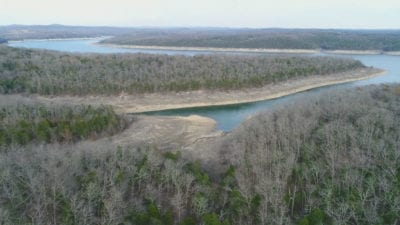 Aerial over the property looking toward the cove and lake.