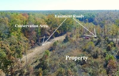 Looking over the southeast corner of the property with the conservation land on the left.